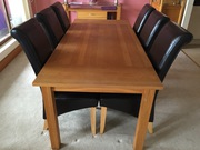 Dining room table solid oak & 6 black leather chairs