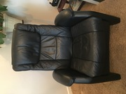 Black Leather Recliner with foot rest.