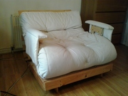 A lovely single wooden Futon for sale